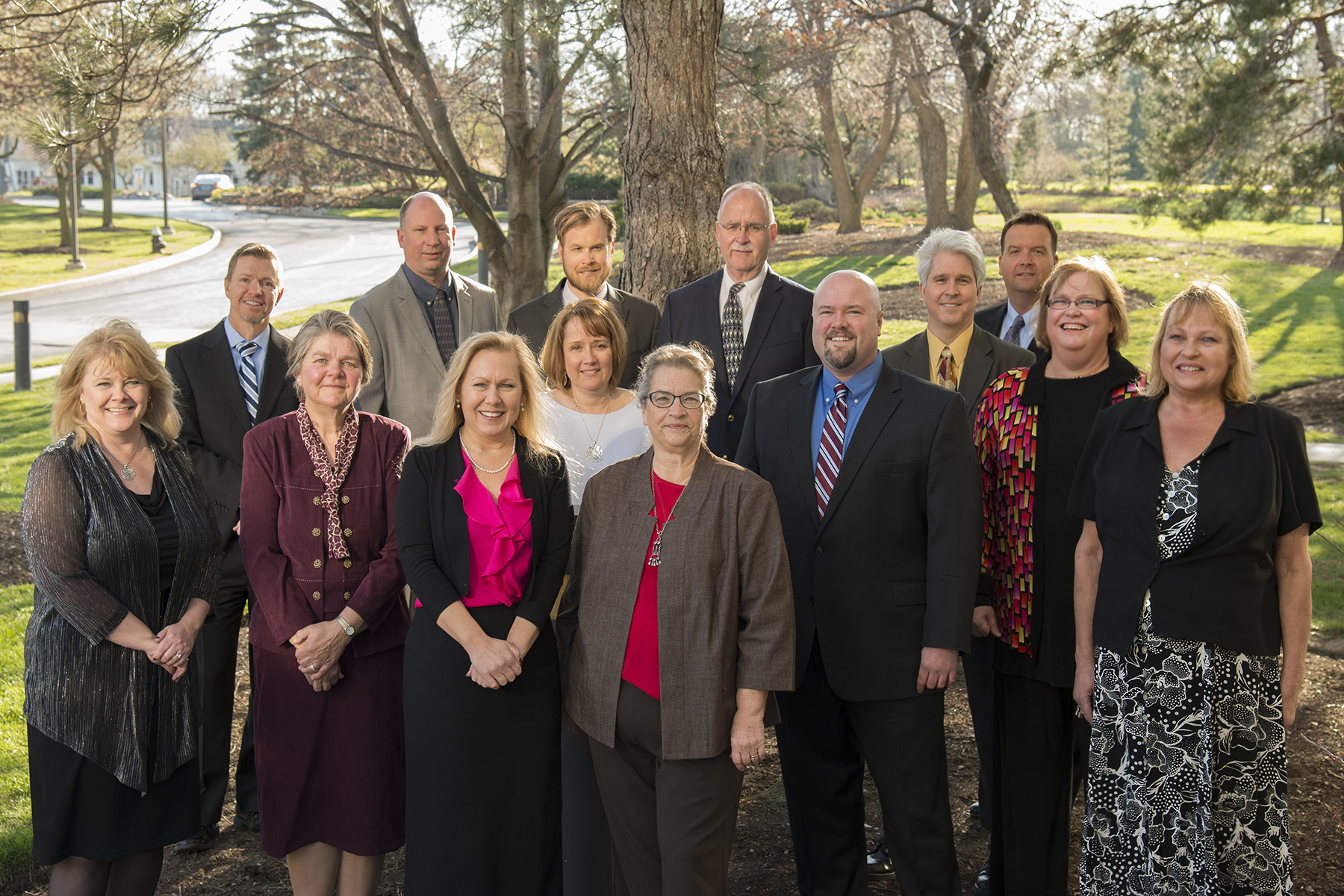 A sunny outside picture of  the 14 LCCU  Staff and Board members.